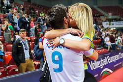 Dejan Vincic #9 of Slovenia with his girlfriend celebrate after winning during volleyball match between National teams of Slovenia and Italy in 1st Semifinal of 2015 CEV Volleyball European Championship - Men, on October 17, 2015 in Arena Armeec, Sofia, Bulgaria. Photo by Vid Ponikvar / Sportida
