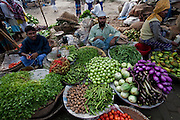 Vegetable vendors wait for customers at the sprawling Sonargaon market, outside Dhaka, Bangladesh.