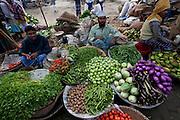 Vegetable vendors wait for customers at the sprawling Sonargaon market, outside Dhaka, Bangladesh.