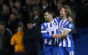 Sam Baldock, Brighton striker scores a goal and celebrates with Craig Mackail-Smith, Brighton striker during the Sky Bet Championship match between Brighton and Hove Albion and Leeds United at the American Express Community Stadium, Brighton and Hove, England on 24 February 2015.