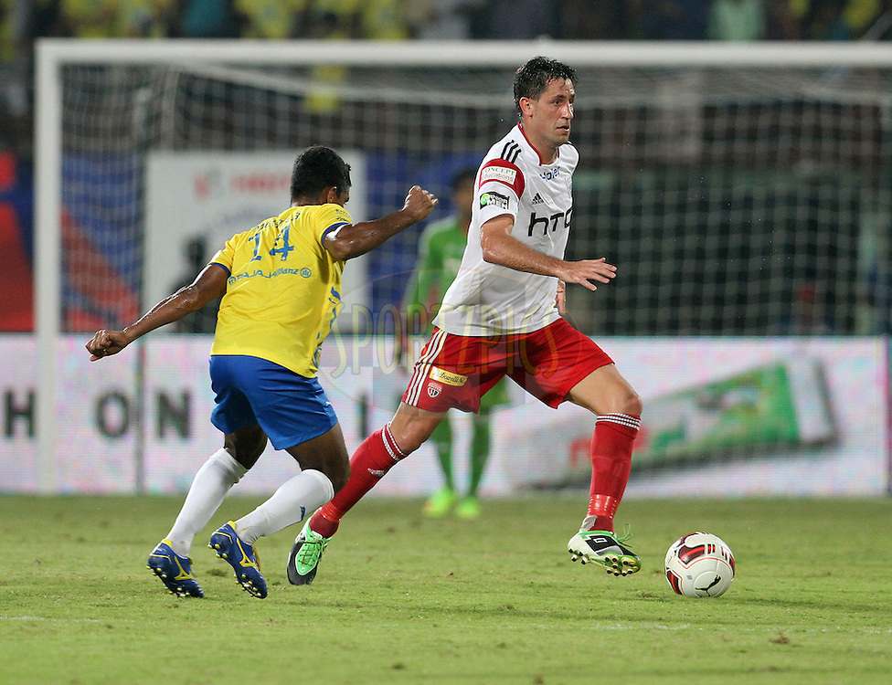 Joan Capdevila Mendez of NorthEast United FC on the attack during match 49 of the Hero Indian Super League between Kerala Blasters FC and North East United FC held at the Jawaharlal Nehru Stadium, Kochi, India on the 4th December 2014.<br /> <br /> Photo by:  Vipin Pawar/ ISL/ SPORTZPICS