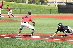 17 April 2016:  Connor Kopach dives back to first ahead of the throw to Derek Parola during an NCAA Division I Baseball game between the Southern Illinois Salukis and the Illinois State Redbirds in Duffy Bass Field, Normal IL