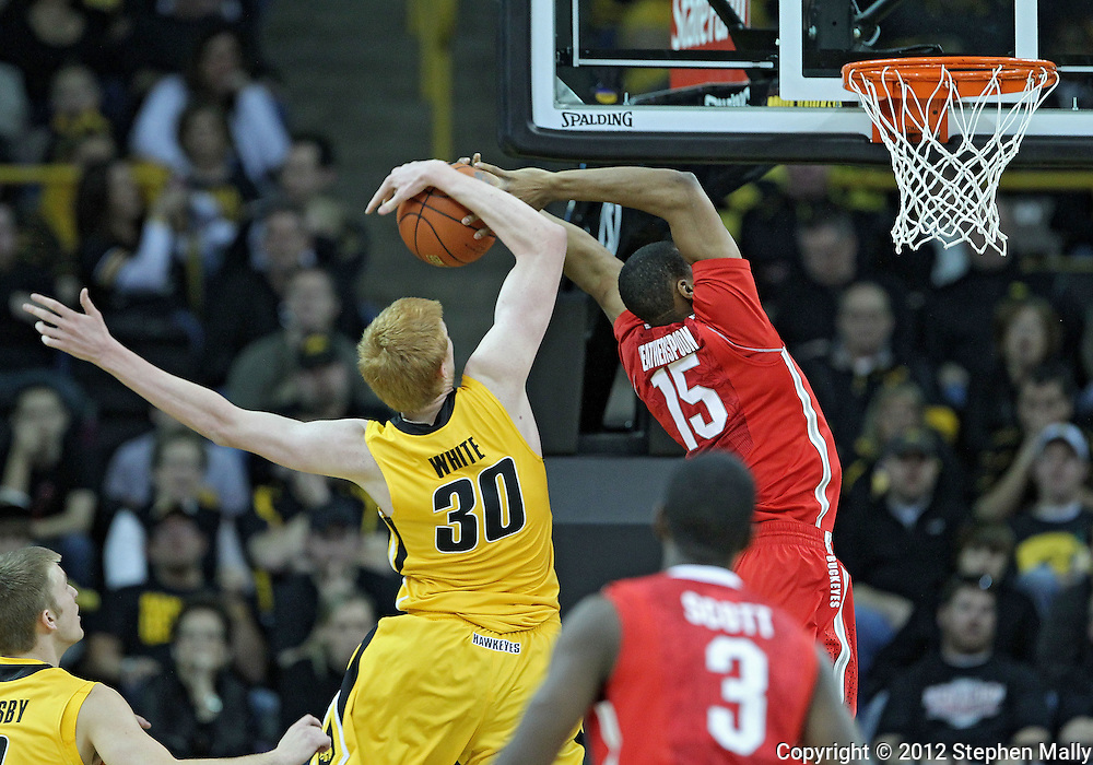 January 07, 2011: Iowa Hawkeyes forward Aaron White (30) blocks a shot by Ohio State Buckeyes forward J.D. Weatherspoon (15) during the the NCAA basketball game between the Ohio State Buckeyes and the Iowa Hawkeyes at Carver-Hawkeye Arena in Iowa City, Iowa on Saturday, January 7, 2012.