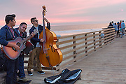 Pismo Beach, California. Musicians on the pier at sunset