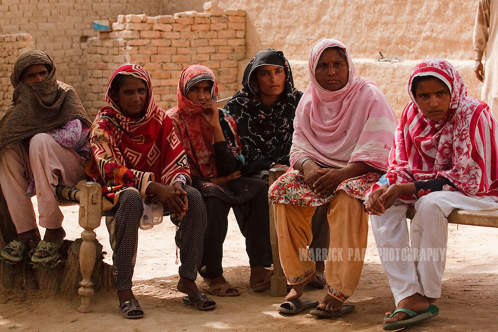 BAHAWALPUR, PAKISTAN - JUNE 18: Acumen Fund beneficiaries meet with Jacqueline Novogratz at a looming site, on June 18, in Moosa Colony, Bahawalpur, Pakistan.  (Photo by Warrick Page)