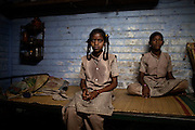 CHENNAI, INDIA, JULY 2012: Kasika, with her two daugheters, hse killed her 3rd daughter under the pressure of her family, she poisoned her with the milk. ,july 2012 © Giulio Di Sturco