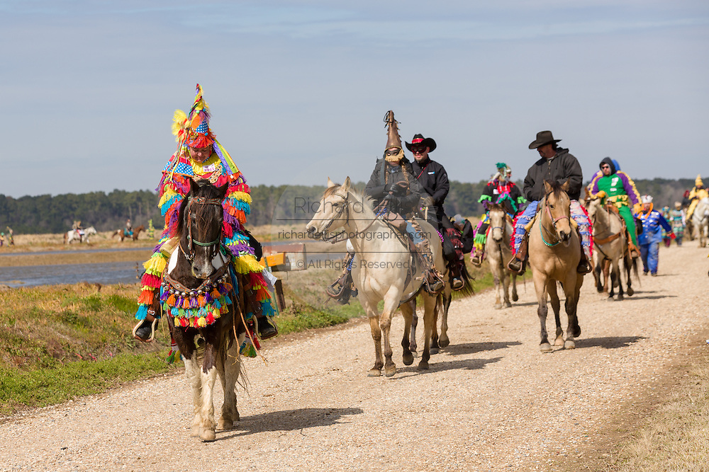 Cajun Mardi Gras revelers ride horses through the countryside during the Eunice Courir de Mardi Gras chicken run on Fat Tuesday February 17, 2015 in Eunice, Louisiana. The traditional event involves costumed villagers traveling from house to house to beg for food to make a gumbo meal.