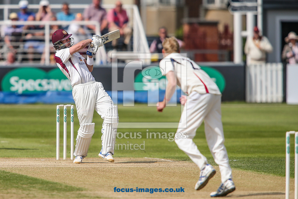 Alex Wakely of Northamptonshire CCC (left) hits the ball over the boundary for six during the Specsavers County C'ship Div Two match at the County Ground, Northampton<br /> Picture by Andy Kearns/Focus Images Ltd 0781 864 4264<br /> 16/05/2016
