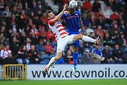 Calvin Andrew wins the ball under pressure from Andy Butler during the EFL Sky Bet League 1 match between Rochdale and Doncaster Rovers at Spotland, Rochdale, England on 13 October 2018.