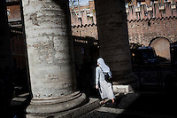 Vatican City - 9 MARCH 2013: A Nun exits Saint Peter's square from the colonnade in Vatican City on March 9, 2013. <br /> <br /> <br /> <br /> Gianni Cipriano for The New York Times