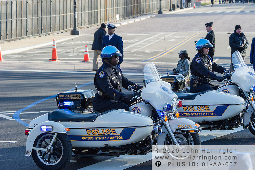 United States Capitol Police motor division riding Harley Davidsons with side cars during the parade for the 57th Presidential Inauguration of President Barack Obama at the U.S. Capitol Building in Washington, DC January 21, 2013.