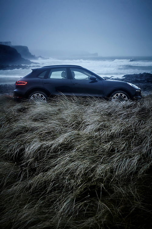 Porsche Macan parked on a grassy dune with rough stormy seas and misty cliffs in the background Ray Massey is an established, award winning, UK professional  photographer, shooting creative advertising and editorial images from his stunning studio in a converted church in Camden Town, London NW1. Ray Massey specialises in drinks and liquids, still life and hands, product, gymnastics, special effects (sfx) and location photography. He is particularly known for dynamic high speed action shots of pours, bubbles, splashes and explosions in beers, champagnes, sodas, cocktails and beverages of all descriptions, as well as perfumes, paint, ink, water – even ice! Ray Massey works throughout the world with advertising agencies, designers, design groups, PR companies and directly with clients. He regularly manages the entire creative process, including post-production composition, manipulation and retouching, working with his team of retouchers to produce final images ready for publication.