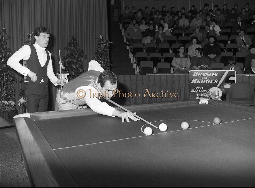 "The Benson and Hedges .Irish Masters Snooker..1984..28.03.1984..03.28.1984..28th March 1984..The championship was held at Goffs,Co Kildare. All the top names in snooker took part..Steve Davis,Jimmy White,Eddie Charlton,.Tony Knowles,Dennis Taylor,Tony Meo,.Alex Higgins,Ray Reardon,.Cliff Thorburn,Terry Griffiths,.Bill Werbeniuk and Eugene Hughes..The eventual winner was Steve Davis who beat Terry Griffiths 9 -1 in the final..Image as Tony Meo ""breaks"" to get the game underway, Jimmy watches the proceedings."