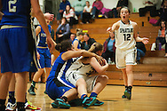 Vergennes' Nikkelette Salley (31) and Winooski's Mariah Metivier (34) battle for the rebound during the girls basketball game between Vergennes and Winooski at Winooski High School on Wednesday night December 9, 2015 in Winooski. (BRIAN JENKINS/for the FREE PRESS)