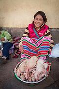 Quechua woman, selling guinea pigs,  San Pedro Market, Cusco, Urubamba Province, Peru