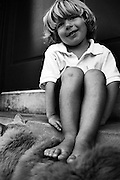 BIRMINGHAM, AL – SEPTEMBER, 2006: A child plays in his front yard.