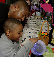 While his father Eric Sr. look on, Eric Devore, Jr., 5, from Huber Heights uses his finger to move some electricity in the Project Read booth during the 5th Annual TechFest at Sinclair Community College, Saturday afternoon.