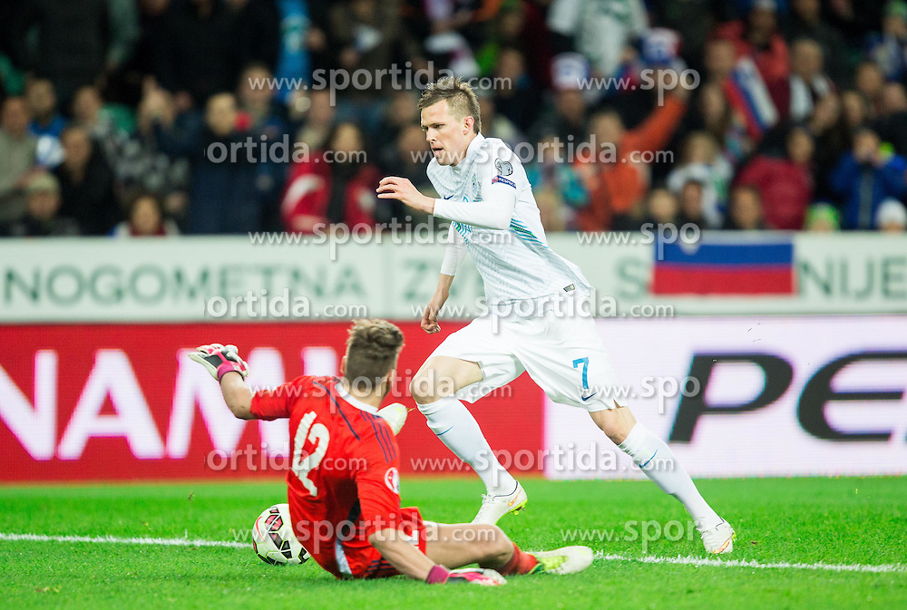 Elia Benedettini of San Marino vs Josip Ilicic of Slovenia when he scores first goal for Slovenia during football match between NationalTeams of Slovenia and San Marino in Round 5 of EURO 2016 Qualifications, on March 27, 2015 in SRC Stozice, Ljubljana, Slovenia. Photo by Vid Ponikvar / Sportida