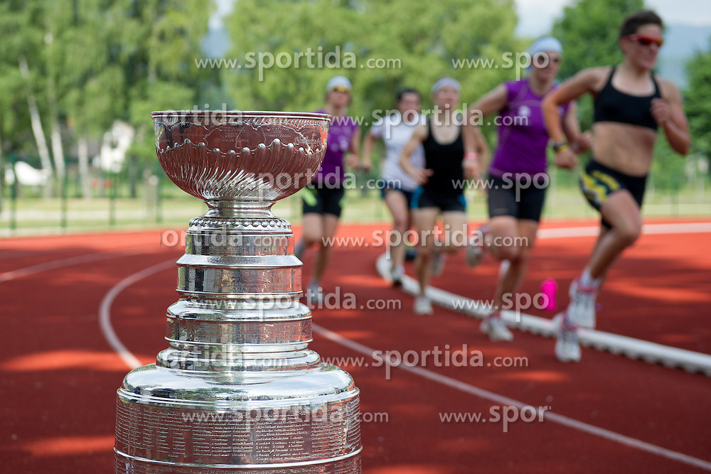 Runners at Ice Hockey NHL Champion Anze Kopitar of LA Kings with Stanley Cup in Slovenia, on July 6, 2012 in Bled, Slovenia. (Photo by Matic Klansek Velej / Sportida)