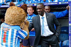New Manager Chris Powell, in his first game in charge of Huddersfield, greets club mascot Terry in the dugout - Photo mandatory by-line: Rogan Thomson/JMP - 07966 386802 - 13/09/2014 - SPORT - FOOTBALL - Huddersfield, England - The John Smith's Stadium - Huddersfield town v Middlesbrough - Sky Bet Championship.