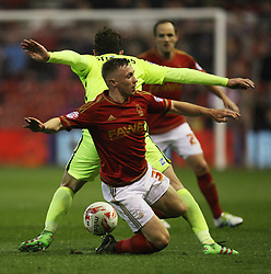 Ben Osborn of Nottingham Forest (C) and Dale Stephens of Brighton & Hove Albion in action - Mandatory by-line: Jack Phillips/JMP - 11/04/2016 - FOOTBALL - City Ground - Nottingham, England - Nottingham Forest v Brighton and Hove Albion - Sky Bet Championship