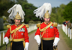 © Licensed to London News Pictures. 15/05/2016. Windsor, UK. Two men in formal military uniform arrive for an evening event held at the Royal Windsor Horse show to celebrate the 90th birthday of HRH Queen Elizabeth II. Acts from arounds the world have been invited to perform at the evening event, set in the grounds of Windsor Castle. Photo credit: Ben Cawthra/LNP