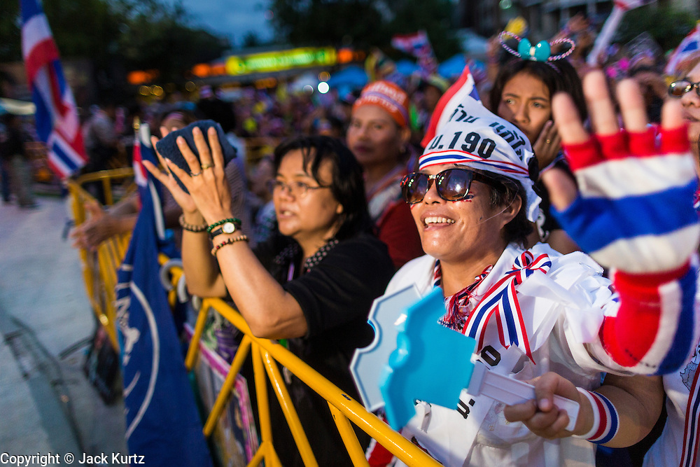 "15 NOVEMBER 2013 - BANGKOK, THAILAND: Thai protests dance during an anti-government protest in Bangkok. Tens of thousands of Thais packed the area around Democracy Monument in the old part of Bangkok Friday night to protest against efforts by the ruling Pheu Thai party to pass an amnesty bill that could lead to the return of former Prime Minister Thaksin Shinawatra. Protest leader and former Deputy Prime Minister Suthep Thaugsuban announced an all-out drive to eradicate the ""Thaksin regime."" The protest Friday was the biggest since the amnesty bill issue percolated back into the public consciousness. The anti-government protesters have vowed to continue their protests even though the Thai Senate voted down the bill, thus killing it for at least six months.     PHOTO BY JACK KURTZ"