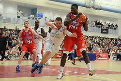 Daniel Edozie of Bristol Flyers is closed down by Tayo Ogedengbe of Surrey Scorchers - Mandatory byline: Dougie Allward/JMP - 07966 386802 - 19/09/2015 - BASKETBALL - SGS Wise Campus - Bristol, England - Bristol Flyers v Surrey Scorchers - British Basketball League