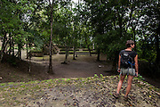 Tourists explore and hike around the Cahal Pech Mayan ruins near the Belizean town of San Ignacio.