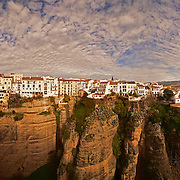 """Very large panorama of Ronda (Spanish pronunciation:[ˈronda]) is a city in the Spanish province of Málaga. It is located about 100 kilometres (62mi) west of the city of Málaga, within the autonomous community of Andalusia. Its population is approximately 35,000 inhabitants.<br /> Around the city are remains of prehistoric settlements dating to the Neolithic Age, including the rock paintings of Cueva de la Pileta. Ronda was however first settled by the early Celts, who, in the 6th century BC called it Arunda. Later Phoenician settlers established themselves nearby to found Acinipo, known locally as Ronda la Vieja, Arunda or Old Ronda. The current Ronda is however of Roman origins,[1] having been founded as a fortified post in the Second Punic War, by Scipio Africanus. Ronda received the title of city at the time of Julius Caesar.<br /> In the 5th century AD Ronda was conquered by the Suebi, led by Rechila, being reconquered in the following century by the Eastern Roman Empire, under whose rule Acinipo was abandoned. Later the Visigoth king Leovigild captured the city. Ronda was part of the Visigoth realm until 713, when it fell to the Arabs, who named it Hisn Ar-Rundah (""""Castle of Rundah"""") and made it the capital of the Takurunna province."""
