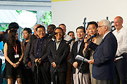 "Venice, Italy. 14th Architecture Biennale 2014, ""fundamentals"".<br /> The Awards Ceremony.<br /> Biennale President Paolo Baratta and the team of the Korean Pavillion who had just won the Golden Lion."