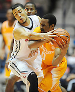 "Tennessee Volunteers guard Kevin Punter (0) gets off a pass against Mississippi Rebels forward Anthony Perez (13) at the C.M. ""Tad"" Smith Coliseum in Oxford, Miss. on Saturday, February 21, 2015. (AP Photo/Oxford Eagle, Bruce Newman)"