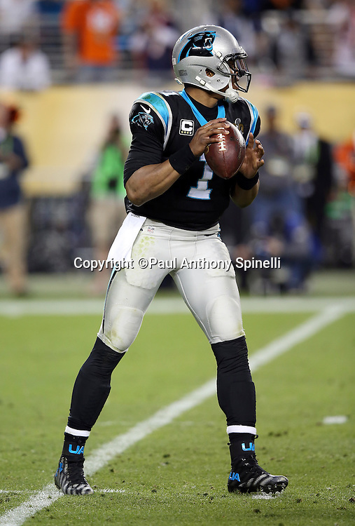 Carolina Panthers quarterback Cam Newton (1) drops back to pass in the fourth quarter during the NFL Super Bowl 50 football game against the Denver Broncos on Sunday, Feb. 7, 2016 in Santa Clara, Calif. The Broncos won the game 24-10. (©Paul Anthony Spinelli)