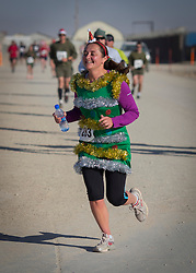 25/12/2013.  Troops in Afghanistan take part in the Camp Bastion Santa Half Marathon today. This Christmas will be the last time the UK Armed Forces will be deployed on operations in the country before the end of Op Herrick in 2014.  Photo credit: Alison Baskerville/LNP