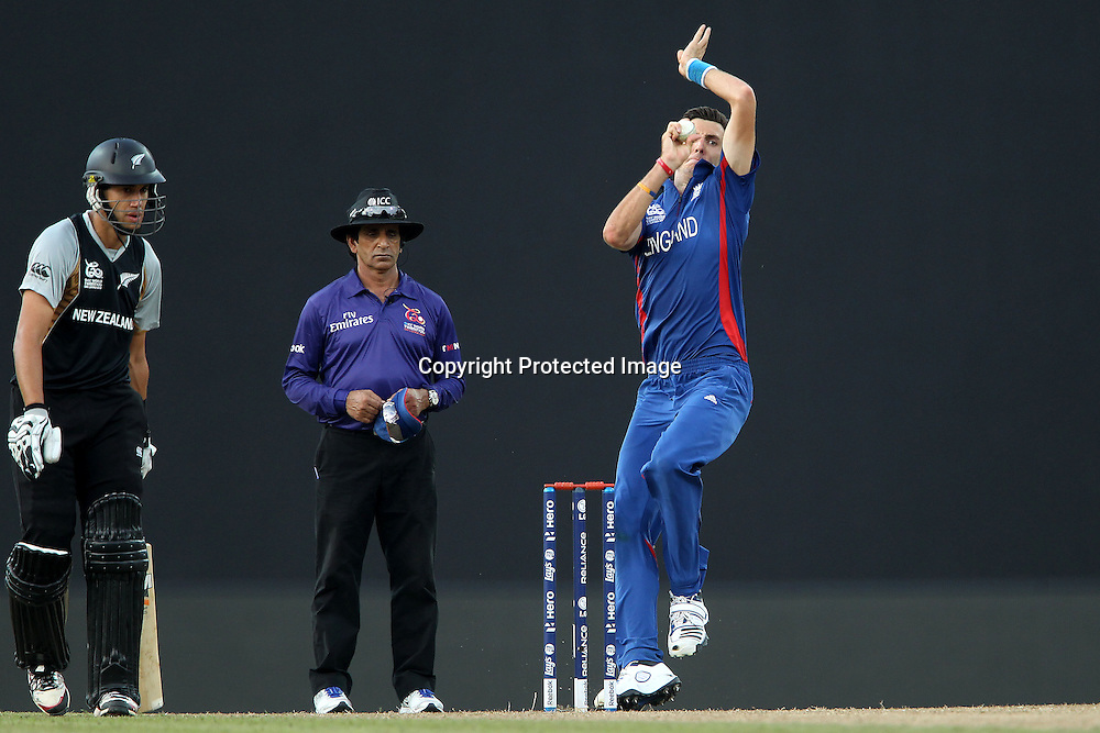Steven Finn of England bowls as Ross Taylor (Captain) prepares to run during the ICC World Twenty20 Super 8s match between England and New Zealand held at the  Pallekele Stadium in Kandy, Sri Lanka on the 29th September 2012<br /> <br /> Photo byRon Gaunt/SPORTZPICS/PHOTOSPORT