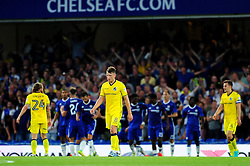 Ollie Clarke of Bristol Rovers cuts a dejected figure as Michy Batshuayi of Chelsea celebrates with team mates - Mandatory by-line: Dougie Allward/JMP - 23/08/2016 - FOOTBALL - Stamford Bridge - London, England - Chelsea v Bristol Rovers - EFL Cup second round