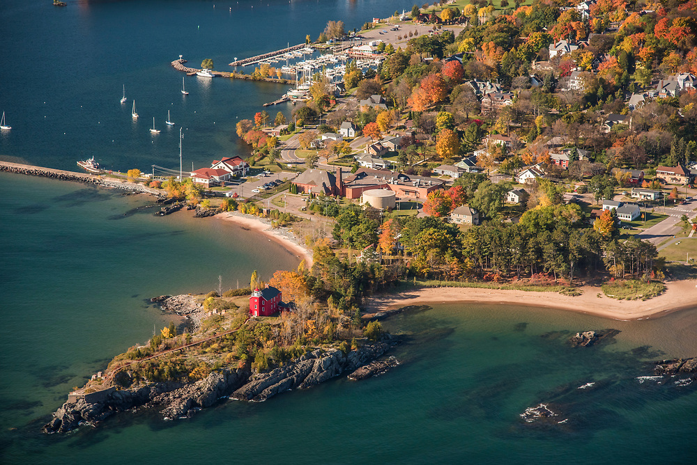 Aerial photography of the Marquette Lighthouse in Marquette Michigan on Lake Superior with fall color.