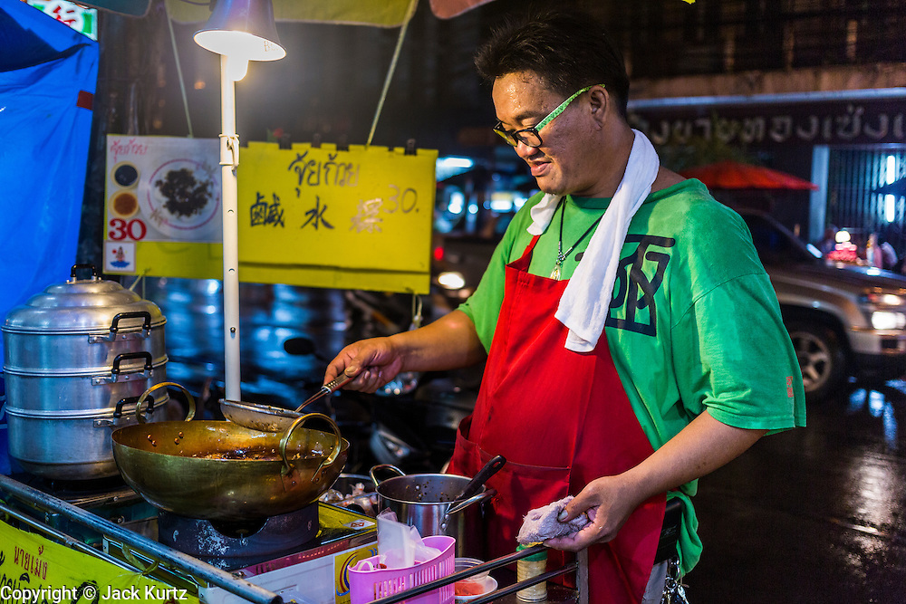 18 SEPTEMBER 2013 - BANGKOK, THAILAND:  A vendor makes a soup at his street stall in the Chinatown section of Bangkok. Thailand in general, and Bangkok in particular, has a vibrant tradition of street food and eating on the run. In recent years, Bangkok's street food has become something of an international landmark and is being written about in glossy travel magazines and in the pages of the New York Times.     PHOTO BY JACK KURTZ