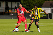 Luke Summerfield & Cecil Nyoni during the Friendly match between Harrogate Town and York City at Wetherby Road, Harrogate, United Kingdom on 25 July 2015. Photo by Simon Davies.