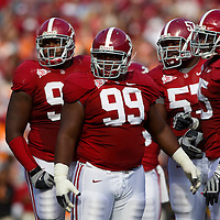 TUSCALOOSA, AL -- October, 24, 2009 -- University of Alabama defensive lineman Brandon Deaderick, left to right, Josh Chapman, Marcell Dareus, and linebacker Rolando McClain listen for calls from the sideline against the University of Tennessee during the Crimson Tide's 12-10 victory over the Volunteers at Bryant-Denny Stadium in Tuscaloosa, Ala., Saturday, Oct. 24, 2009.