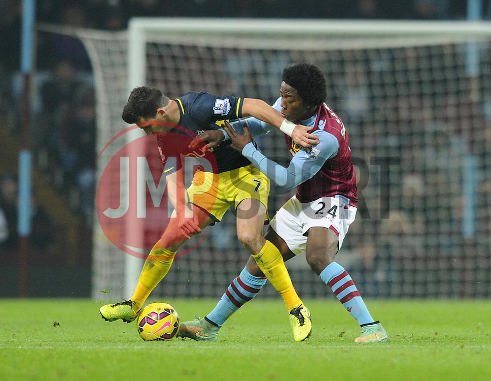 Aston Villa's Carlos Sanchez closes down Southampton's Shane Long - Photo mandatory by-line: Dougie Allward/JMP - Mobile: 07966 386802 - 24/11/2014 - SPORT - Football - Birmingham - Villa Park - Aston Villa v Southampton - Barclays Premier League