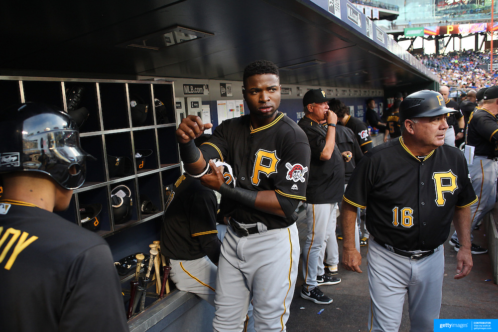 NEW YORK, NEW YORK - June 15: Gregory Polanco #25 of the Pittsburgh Pirates in the dugout preparing to bat during the Pittsburgh Pirates Vs New York Mets regular season MLB game at Citi Field on June 15, 2016 in New York City. (Photo by Tim Clayton/Corbis via Getty Images)
