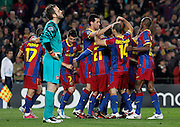 FC Barcelona's players celebrate goal in presence of Arsenal's Manuel Almunia dejected during UEFA Champions League match.March 8,2011.