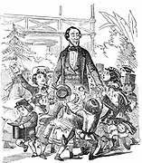 Hans Christian Andersen (1805-1875) Danish author, particularly remembered for his fairy tales. Andersen surrounded by children. Cartoon from 'Punch' London 10 January 1857 celebrating his visit to Britain. Wood engraving