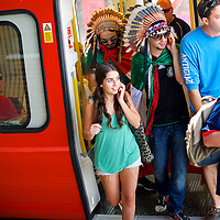 Mexican fans wearing Native American headresses (R-L) Rodrigo Castro, from Mexico City, and Emilio Valencia, from Guadalajar, Mexico, exit the tube at Wembley Park before the Brazil and Mexico gold medal final soccer game at Wembley Stadium during the 2012 London Summer Olympics.
