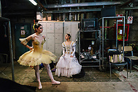 "PALERMO, ITALY - 18 FEBRUARY 2018: (L-R) Ballerinas Chiara Sgnaolin and Simona Filippone are seen here backstage during the dress rehearsal of ""Don Quixote"" at the Teatro Massimo in Palermo, Italy, on February 18th 2018.<br /> <br /> The Teatro Massimo Vittorio Emanuele is an opera house and opera company located  in Palermo, Sicily. It was dedicated to King Victor Emanuel II. It is the biggest in Italy, and one of the largest of Europe (the third after the Opéra National de Paris and the K. K. Hof-Opernhaus in Vienna), renowned for its perfect acoustics. It was inaugurated in 1897."