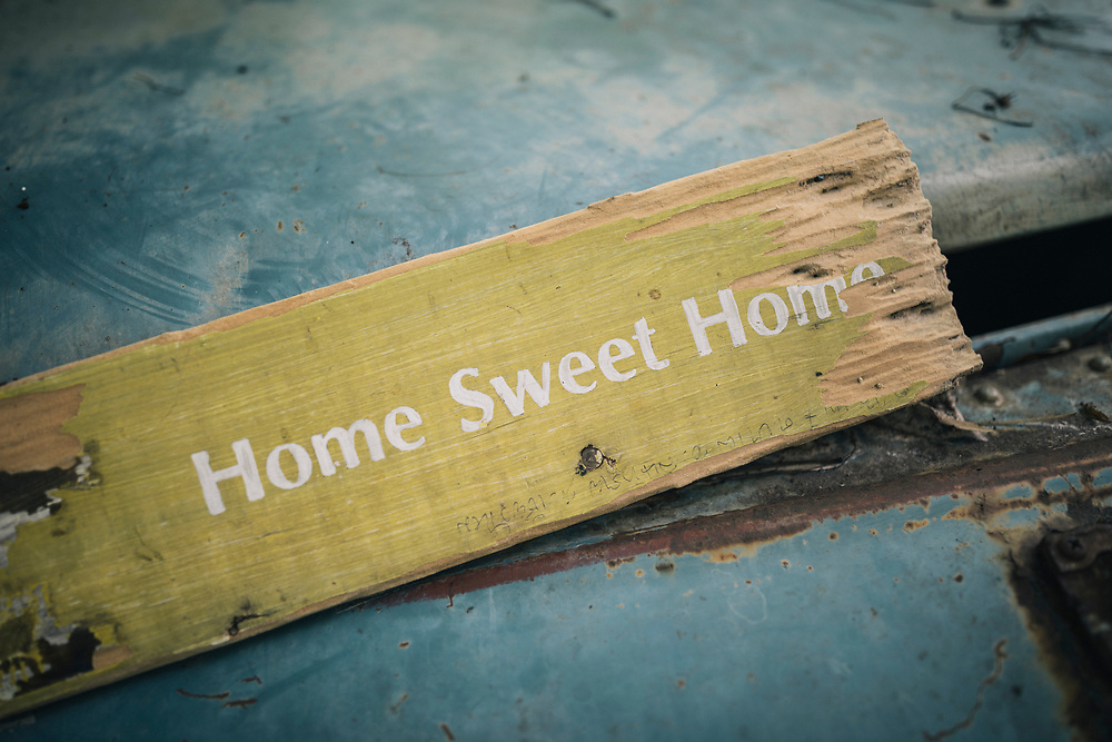 "Chiang Mai, Thailand -- May 20, 2017: A small sign that says ""Home Sweet Home"" at the Suan Sati Yoga Retreat in the countryside of Chiang Mai in northern Thailand."