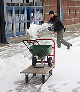 UD Senior Peter Gallant, from Columbus, shovels some snow before the women's basketball game at the University of Dayton Arena, January 21, 2007.  Want to guess what he'll do next?