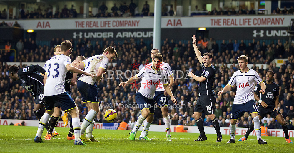 LONDON, ENGLAND - Sunday, November 30, 2014: Tottenham Hotspur's Eric Dier appears to handle the ball in the penalty area during the Premier League match against Everton at White Hart Lane. (Pic by David Rawcliffe/Propaganda)