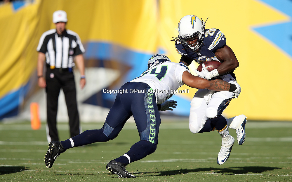 San Diego Chargers running back Melvin Gordon (28) gets hit by Seattle Seahawks middle linebacker Bobby Wagner (54) as he runs the ball in the first quarter during the 2015 NFL preseason football game against the Seattle Seahawks on Saturday, Aug. 29, 2015 in San Diego. The Seahawks won the game 16-15. (©Paul Anthony Spinelli)